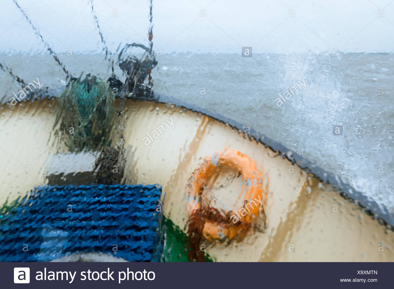 View through the wet window of the bow of the shrimp boat 'Columbus' from Pellworm island, travelling in North Frisian coastal - Stock Image