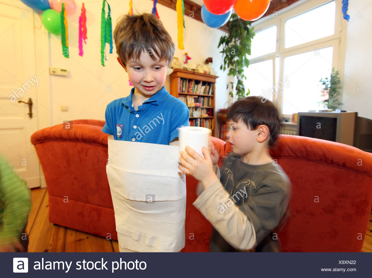 Berlin, Germany, boy wrapped in toilet paper - Stock Image
