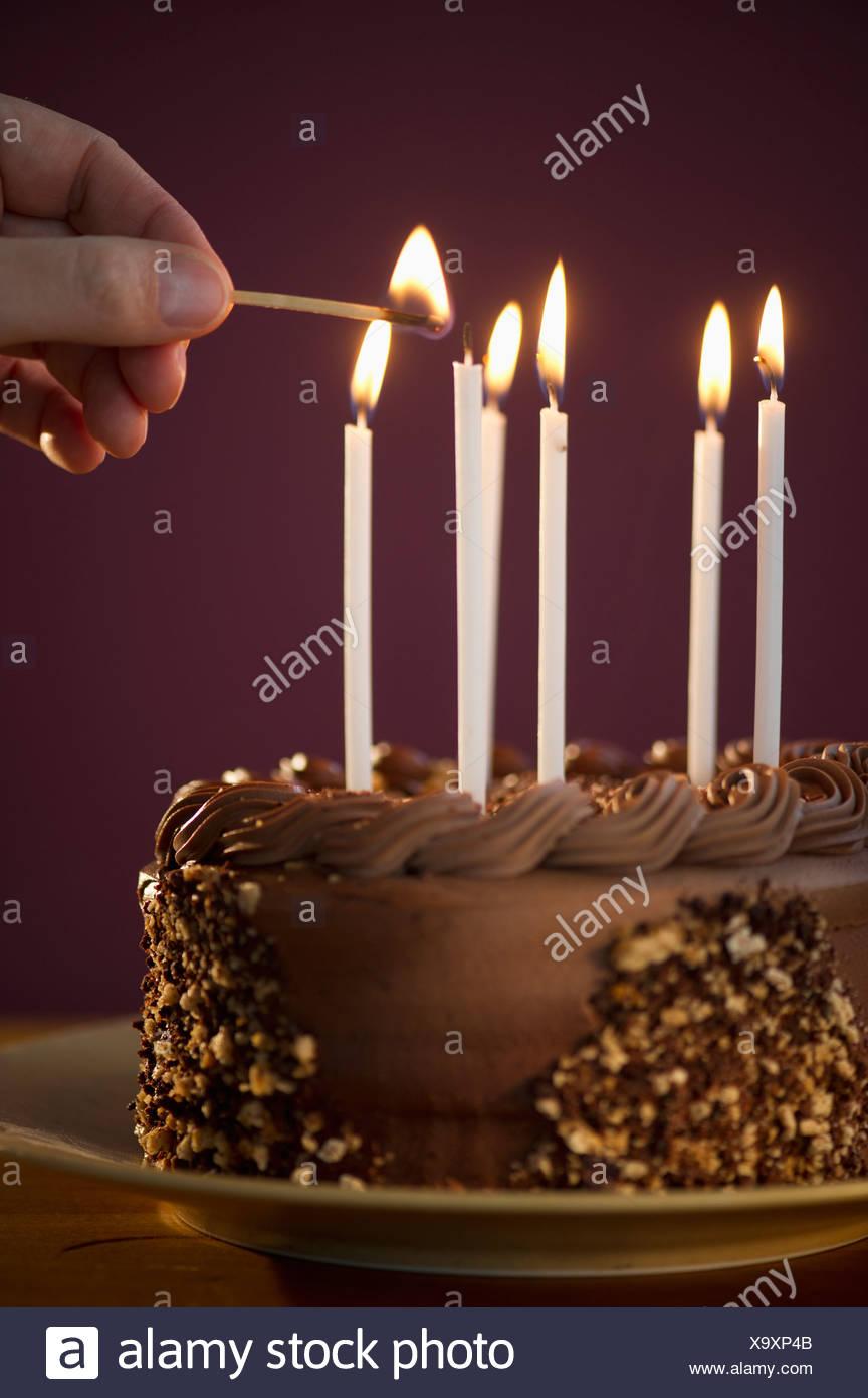 Incredible Studio Shot Of Man Igniting Candles On Chocolate Birthday Cake Birthday Cards Printable Trancafe Filternl