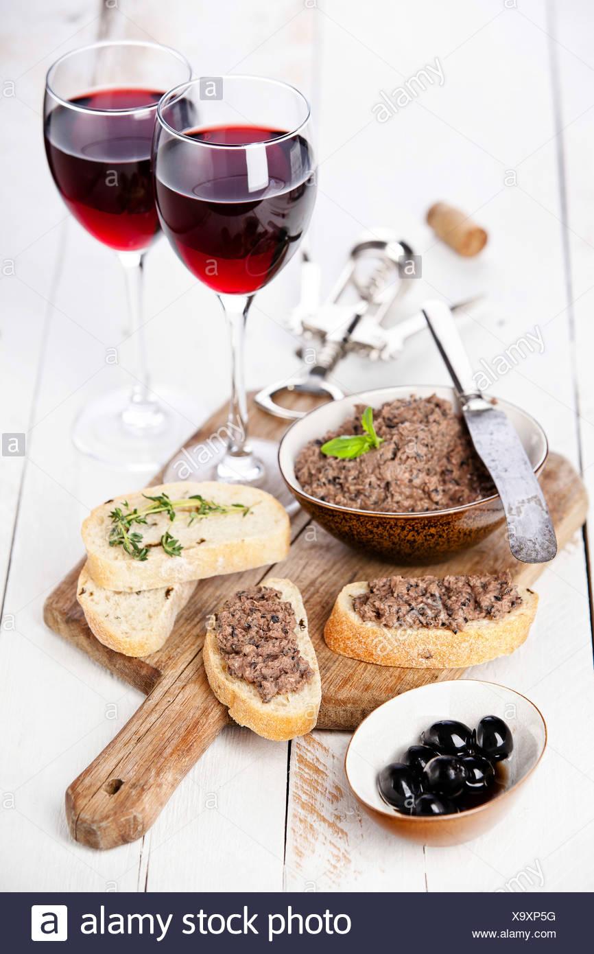 Ciabatta bread with olive paste tapenade - Stock Image