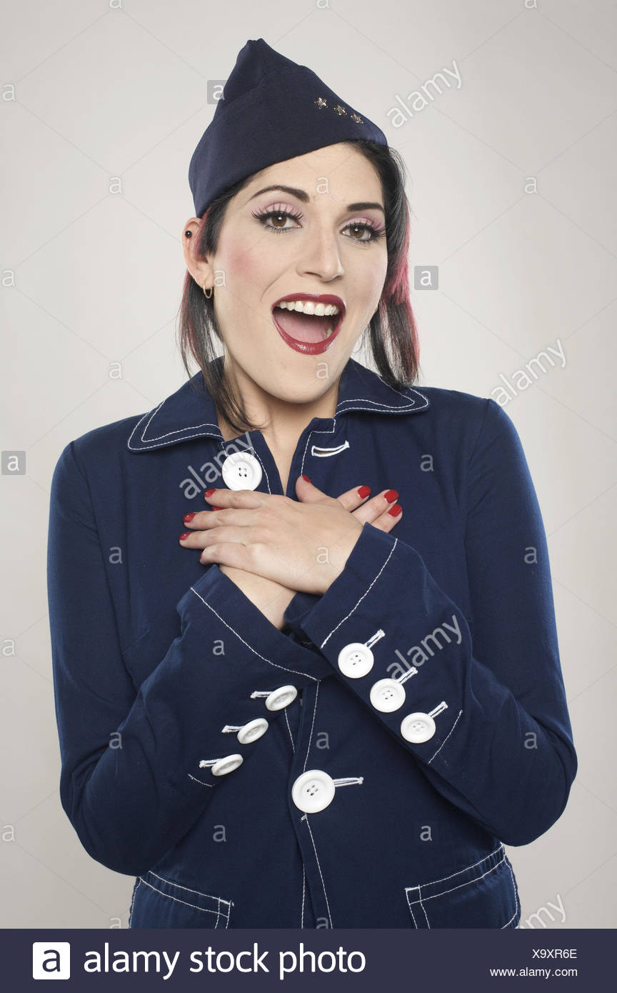 Girl on military outfit looking tenderly surprised at the camera - Stock Image
