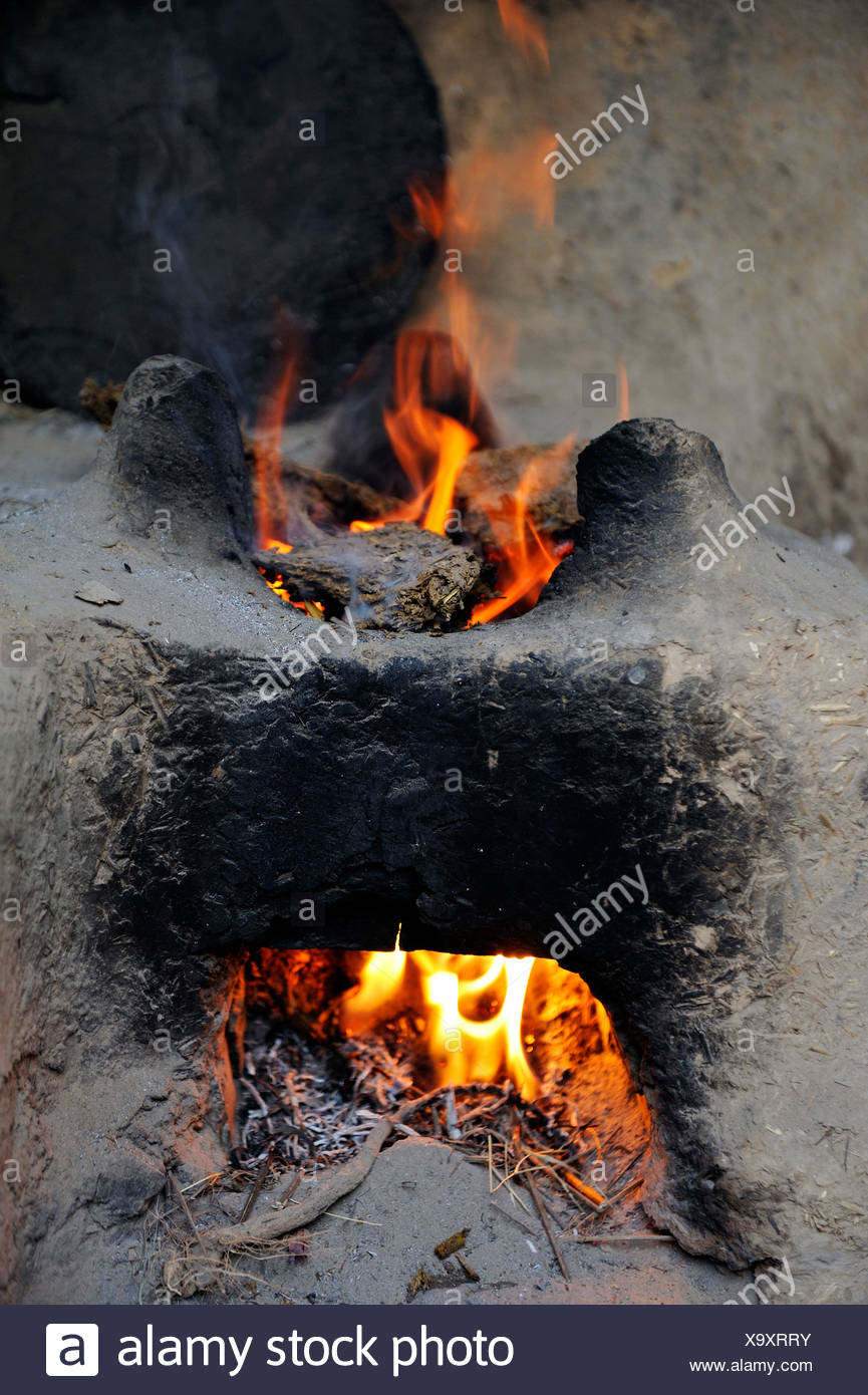 Fire in a simple clay oven, Lahore, Punjab, Pakistan, Asia - Stock Image