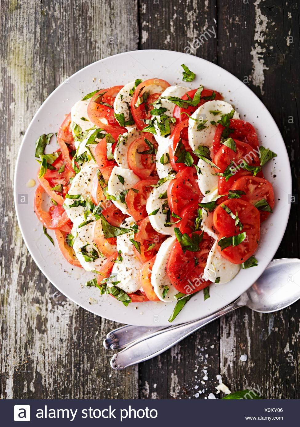 Tomatoes with mozzarella and basil (seen from above) - Stock Image
