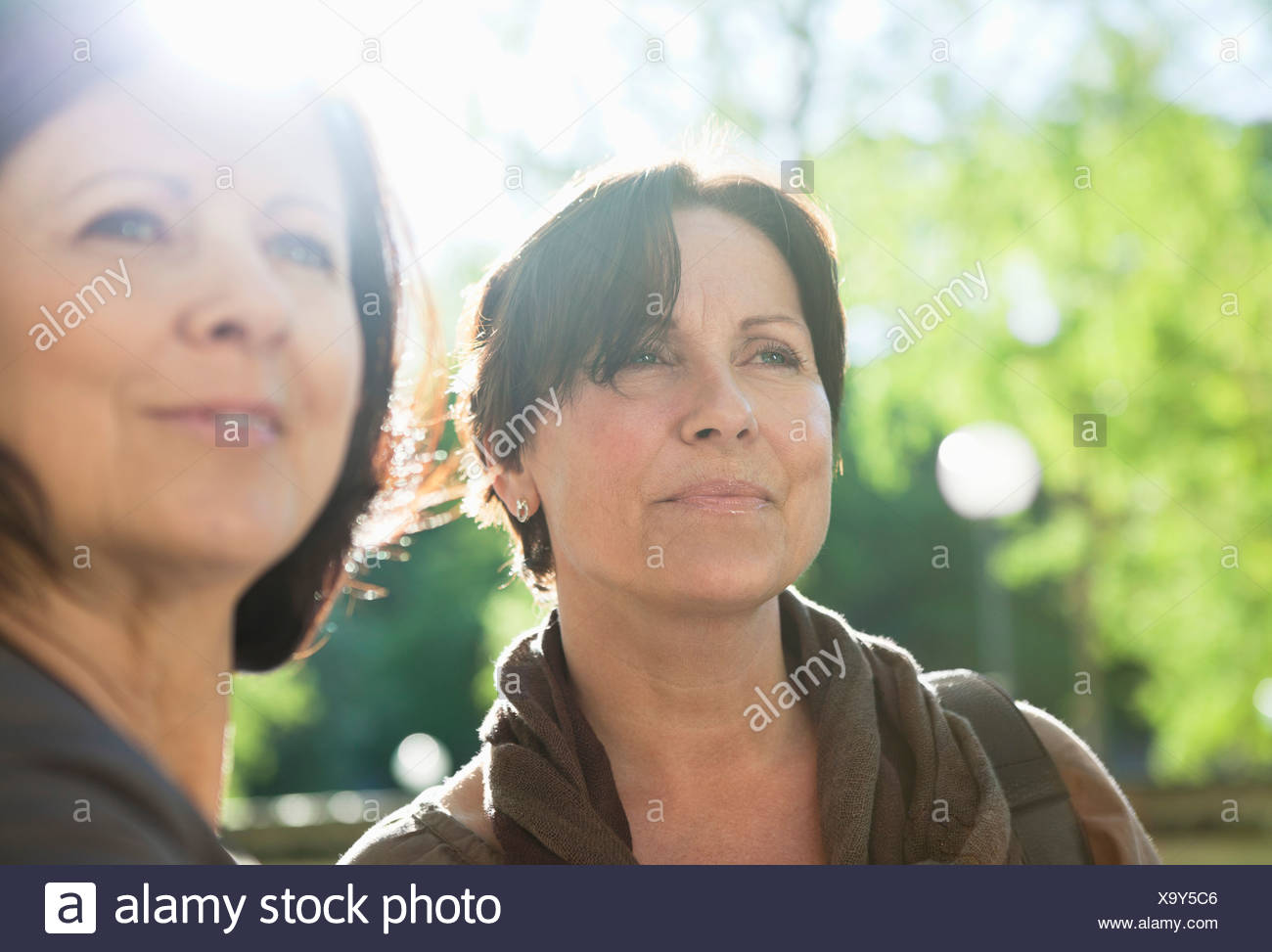 Close-up of smiling woman looking at something - Stock Image