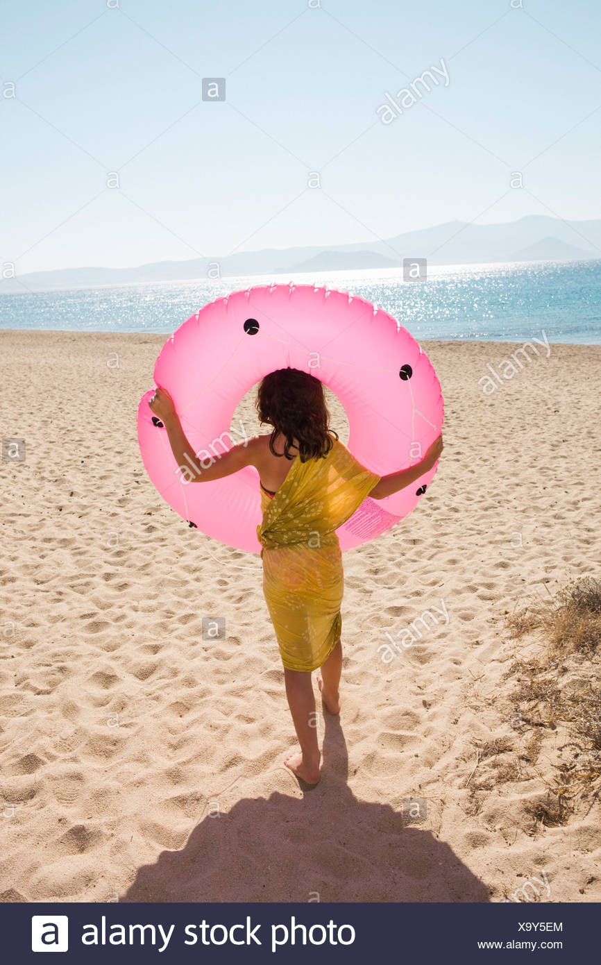 A girl carrying a bathing ring, Greece Stock Photo: 281494828 - Alamy