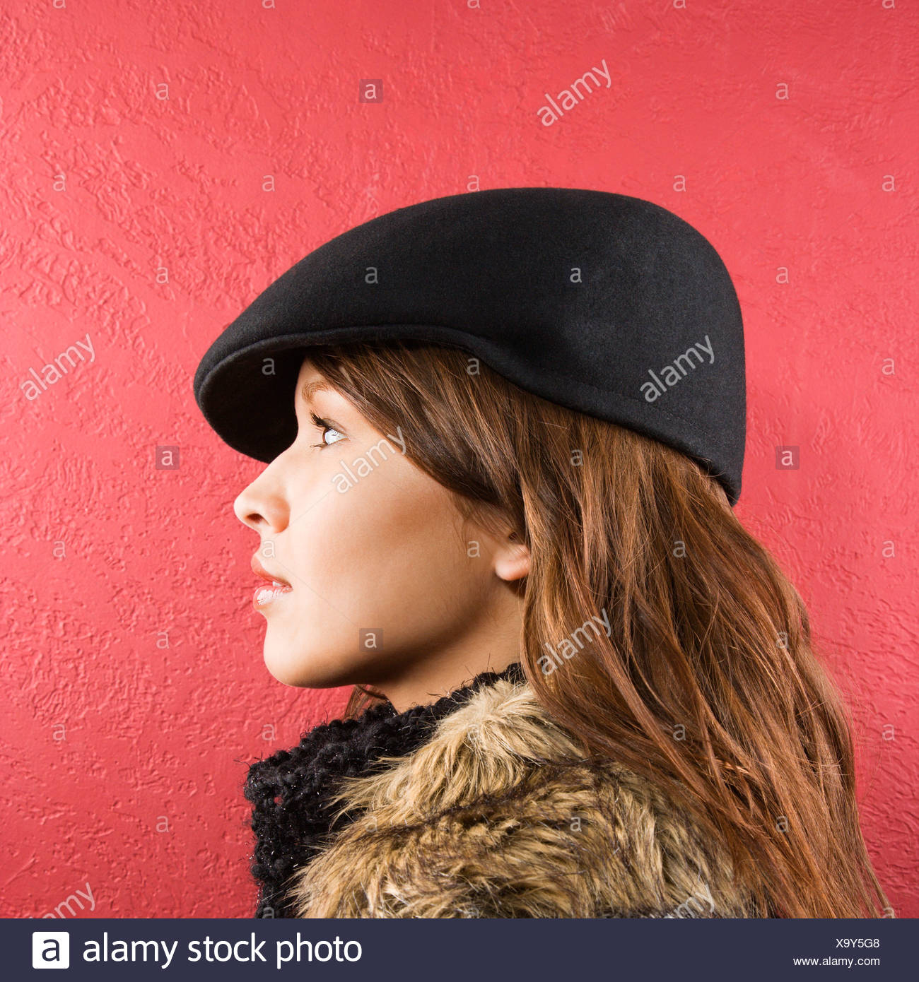 02dcde3c49d5b Profile of young brunette adult Caucasian woman wearing flat hat ...