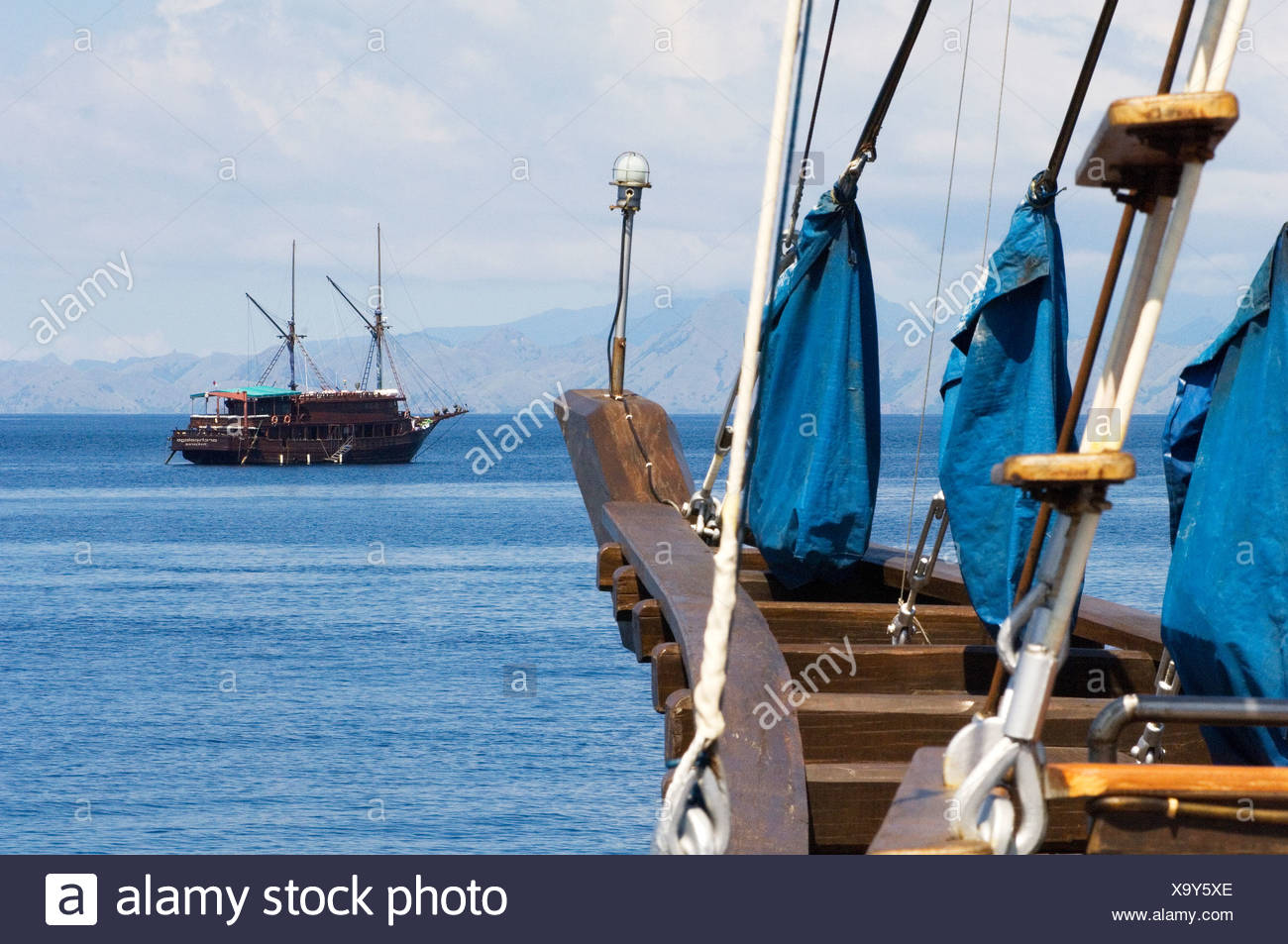 Traditional Indonesian two masted sailing ships, called Pinisi, at anchor. Stock Photo