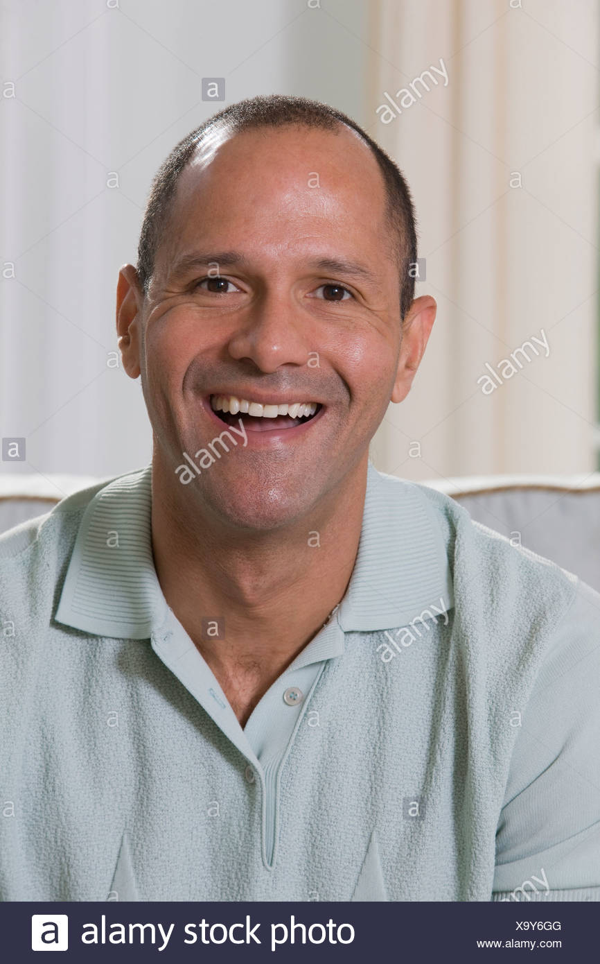 Portrait of a Hispanic man smiling - Stock Image
