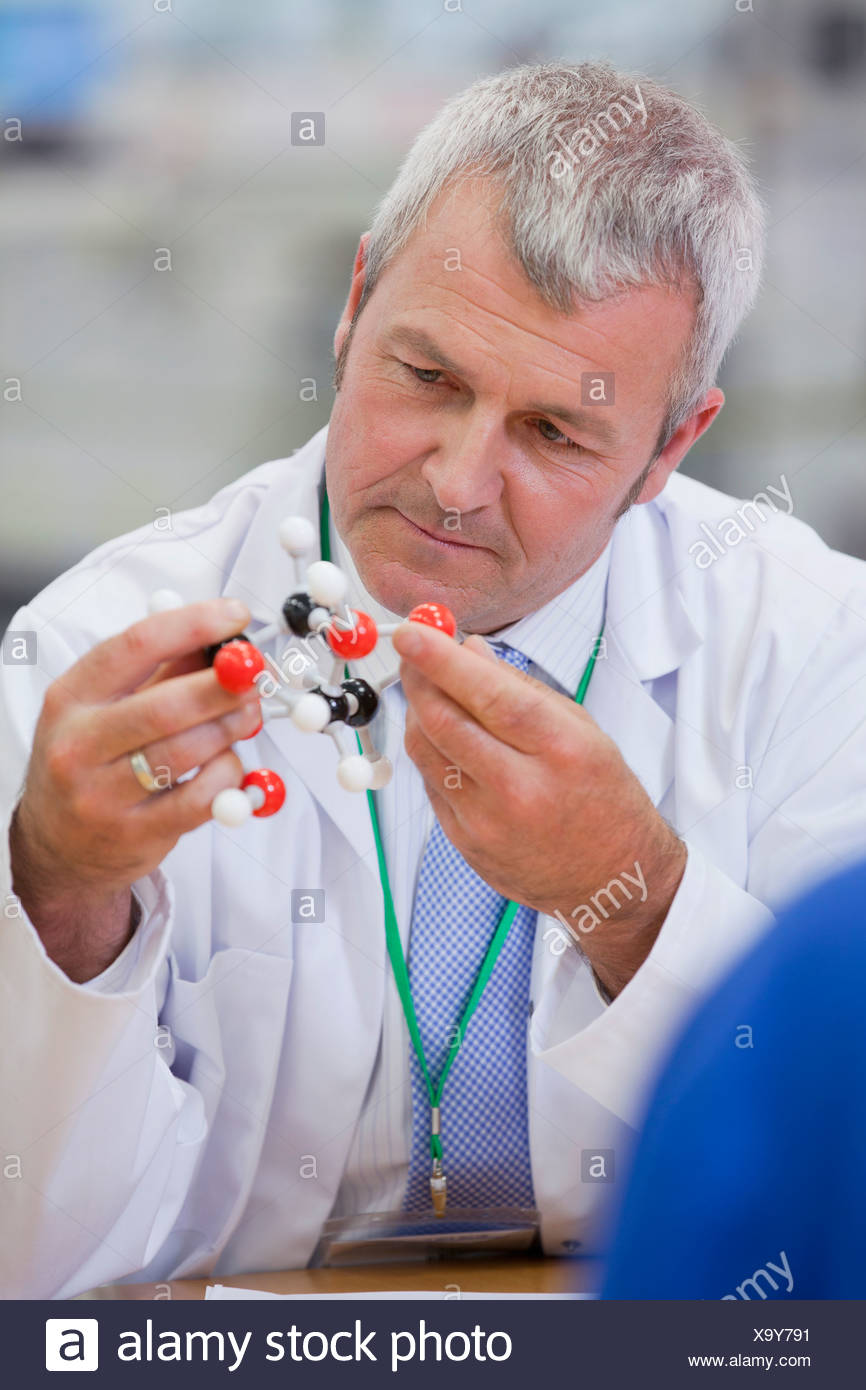 Chemical engineer examining molecular structure - Stock Image
