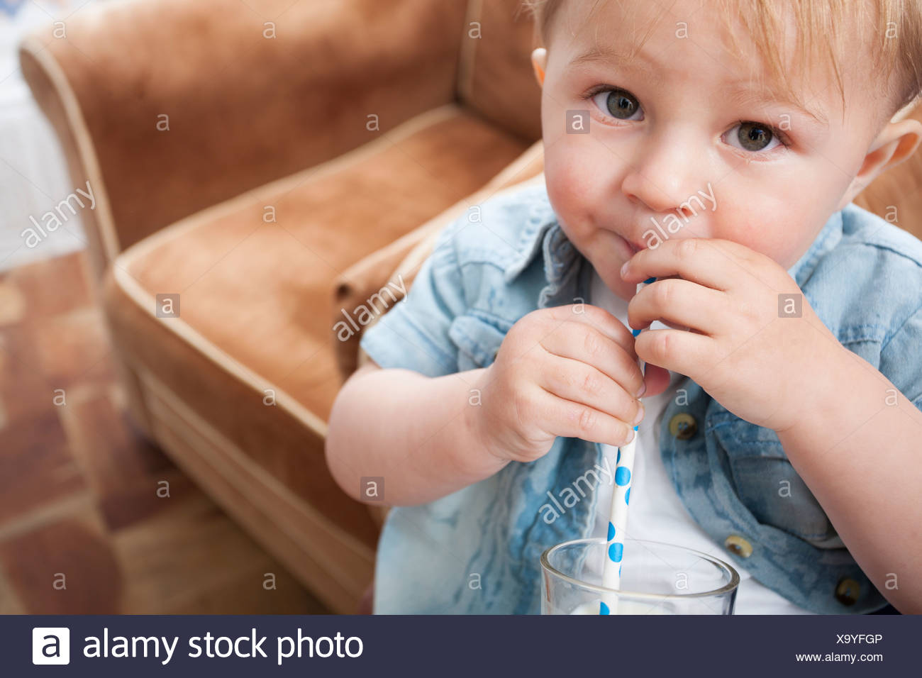 Baby boy drinking milk - Stock Image