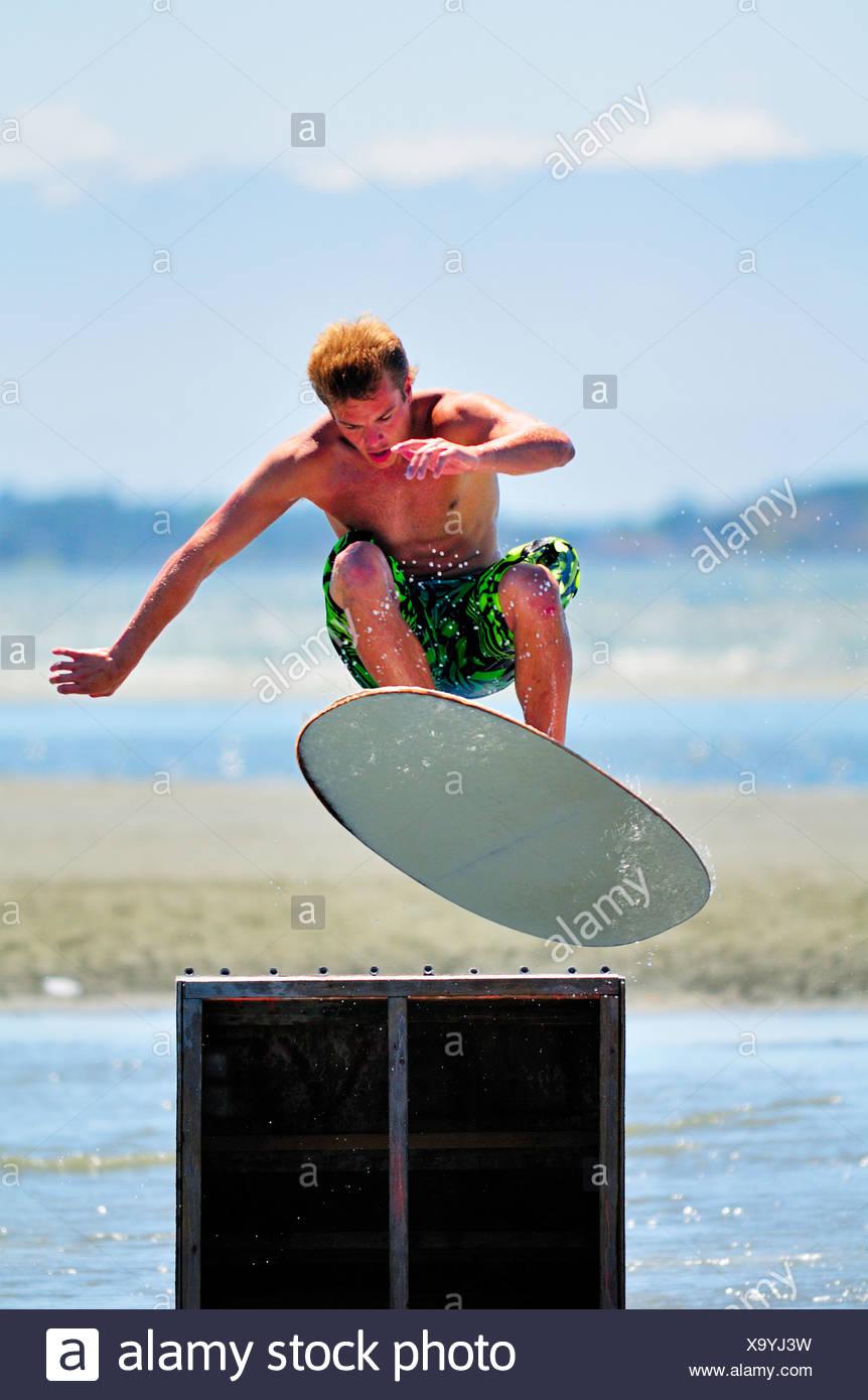 Skimboarder Nick Fraser model release gets some - Stock Image