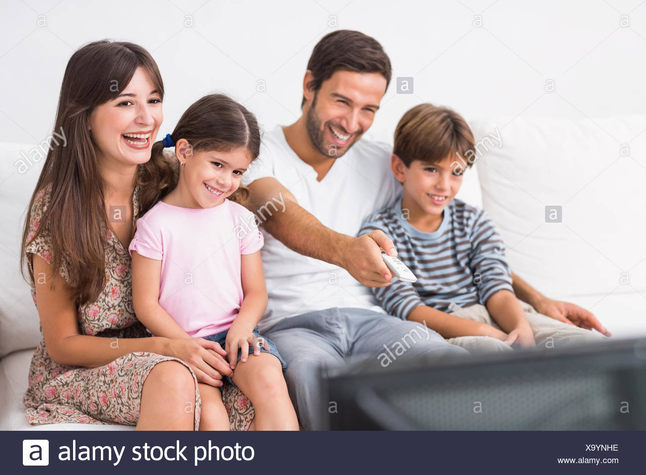 Happy family watching television - Stock Image