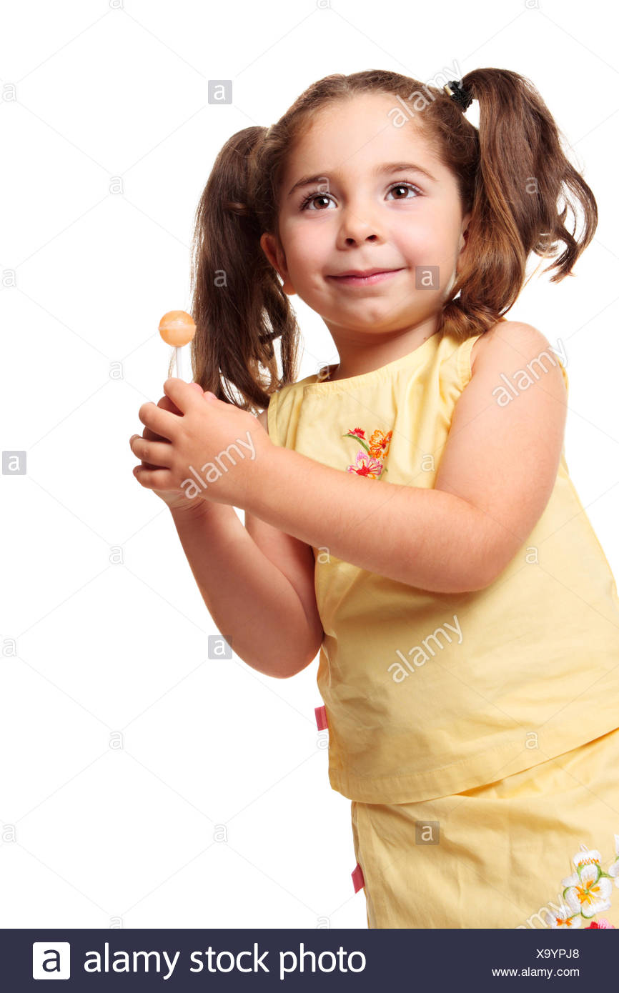Awesome Little Girl In Ponytails Holding A Lollipop Stock Photo 281508256 Natural Hairstyles Runnerswayorg