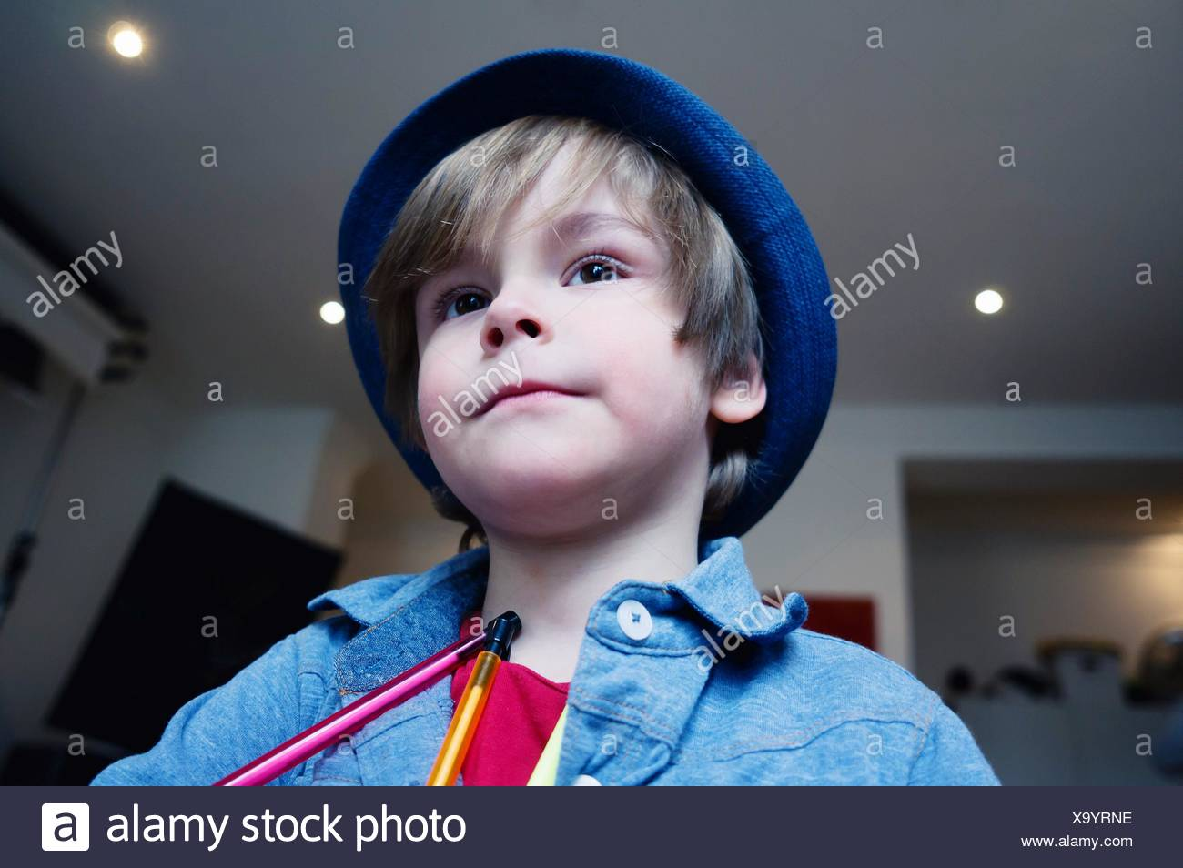 Low Angle View Of Cute Boy With Pencil In House - Stock Image