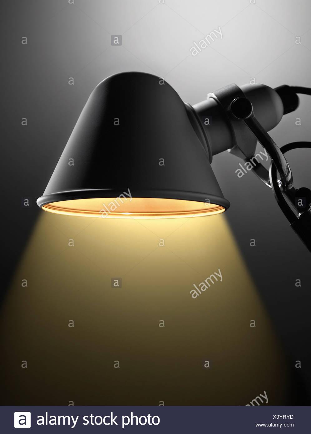 Close up of illuminated desk lamp - Stock Image