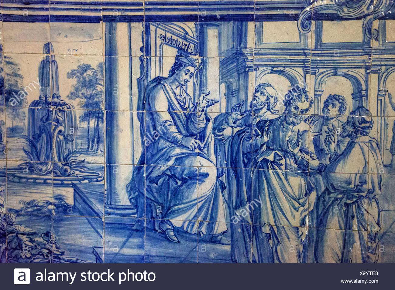 Aristotle teaching, azulejos tiles in the old University of Evora, Colégio do Espírito Santo, Évora, Évora District - Stock Image