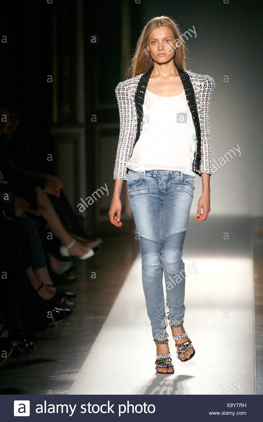 bc24c7ebb162 Balmain Paris Ready to Wear Spring Summer Model wearing light blue denim  jeans, white top, a black and white knitted cardigan