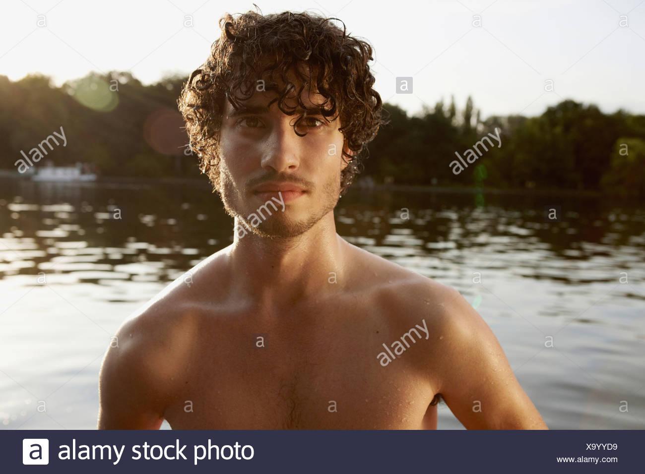 Germany, Berlin, Barechested man, portrait - Stock Image