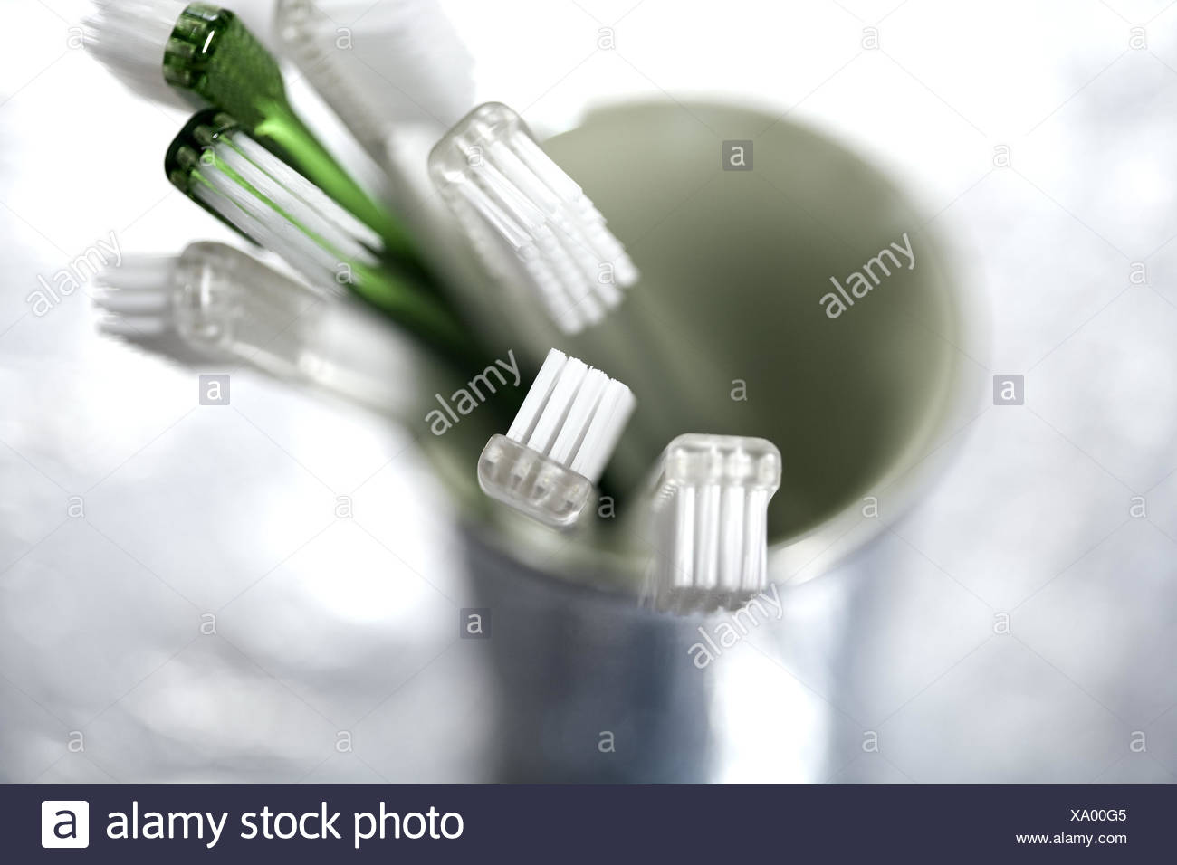 Toothbrush tumbler, toothbrushes, many, detail, blur, - Stock Image