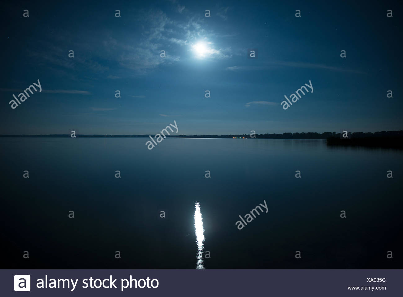 Full moon reflected in the water - Stock Image