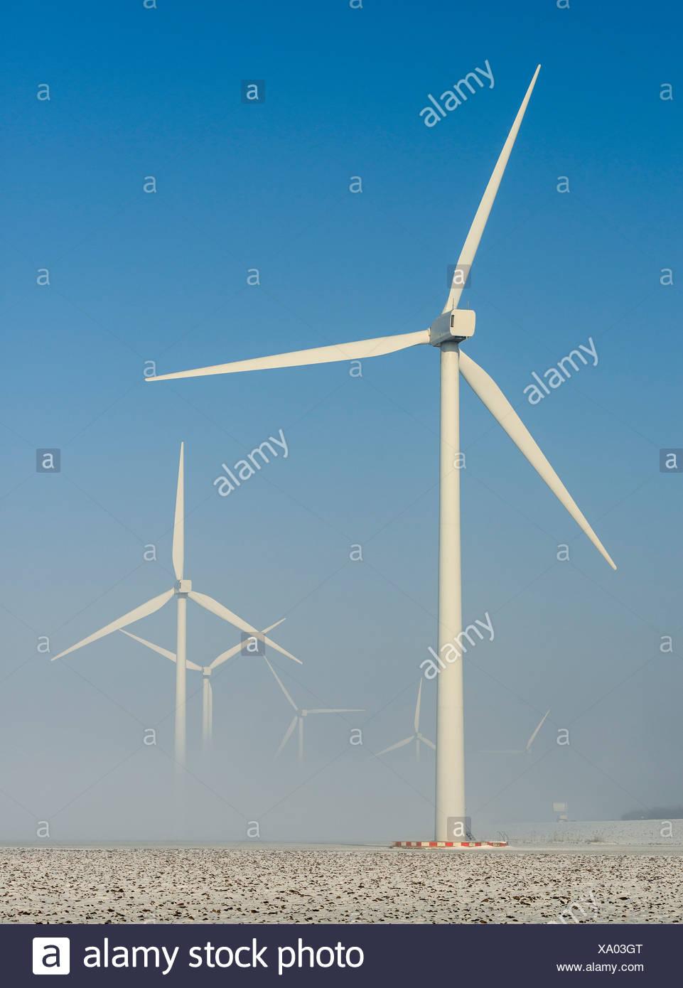 Wind turbines in snowy landscape - Stock Image