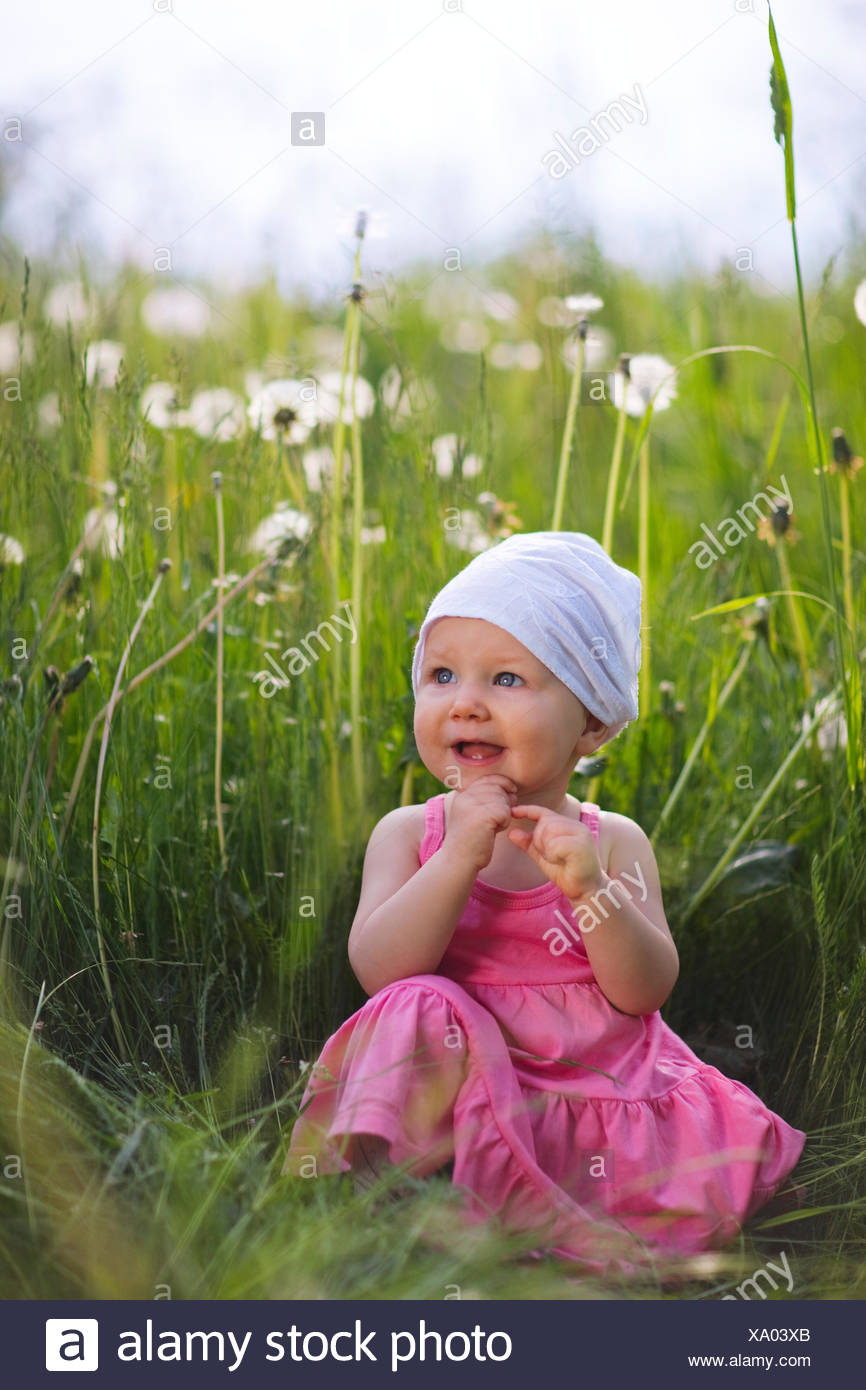 baby girl outdoors at sunny summer day - Stock Image