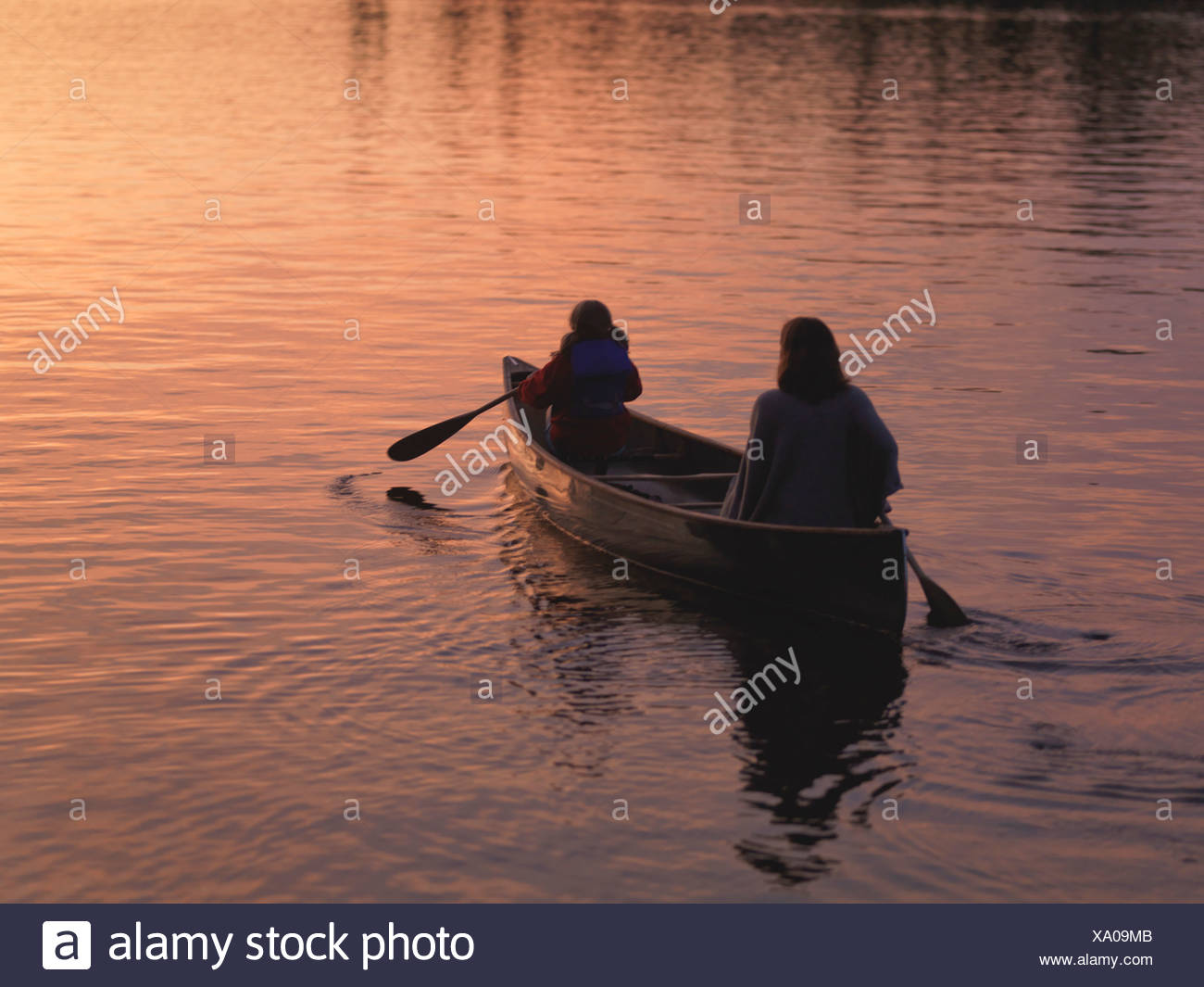 Two people in a canoe, Lake of the Woods, Ontario, Canada - Stock Image