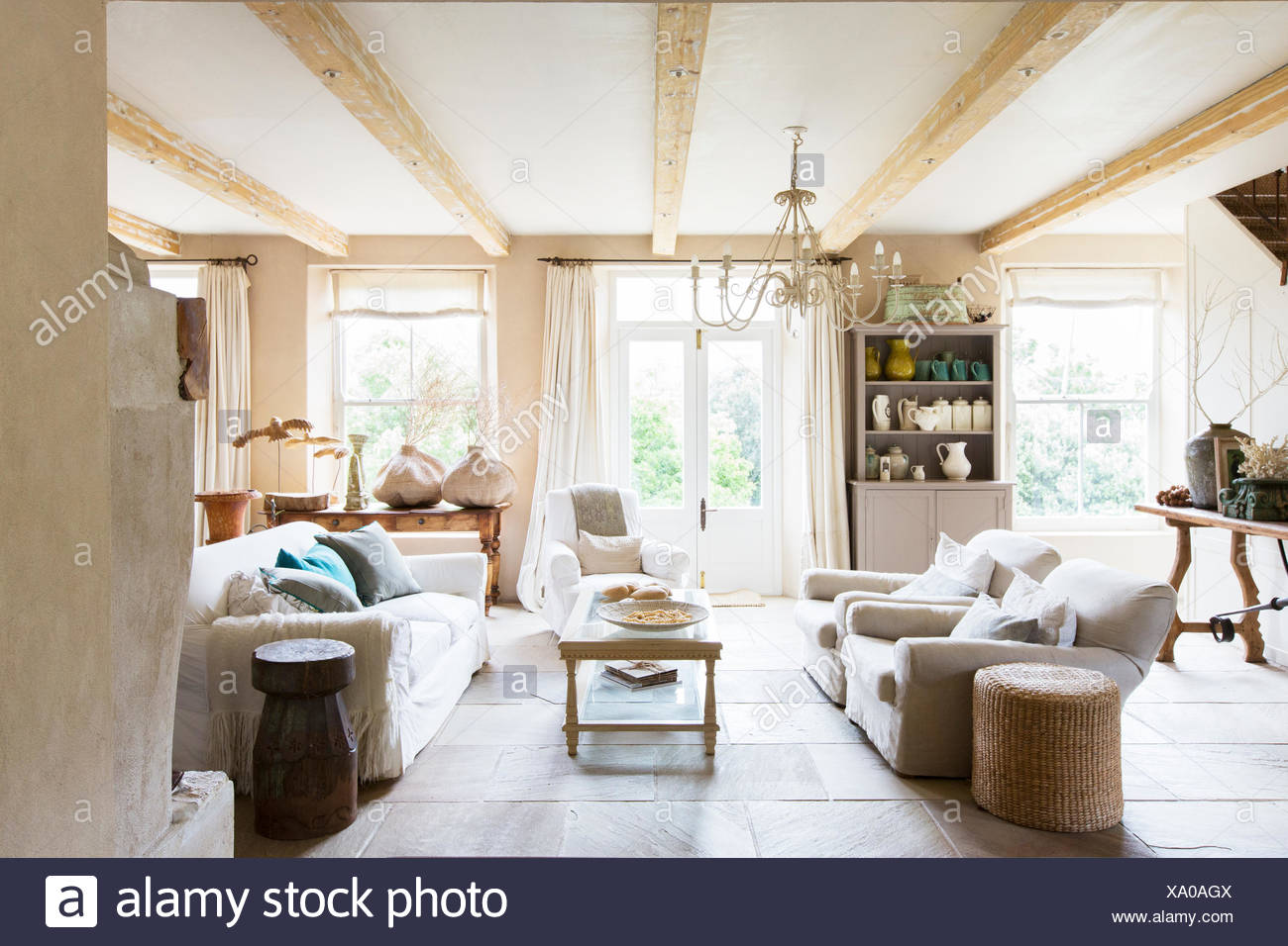 Sofas and coffee table in rustic living room - Stock Image