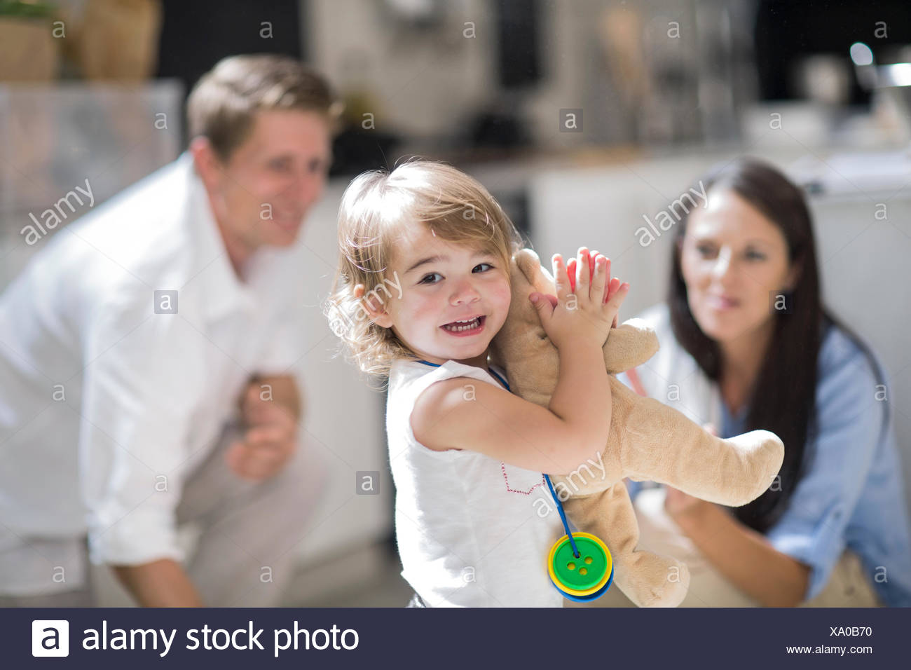 Husband and wife with baby girl - Stock Image