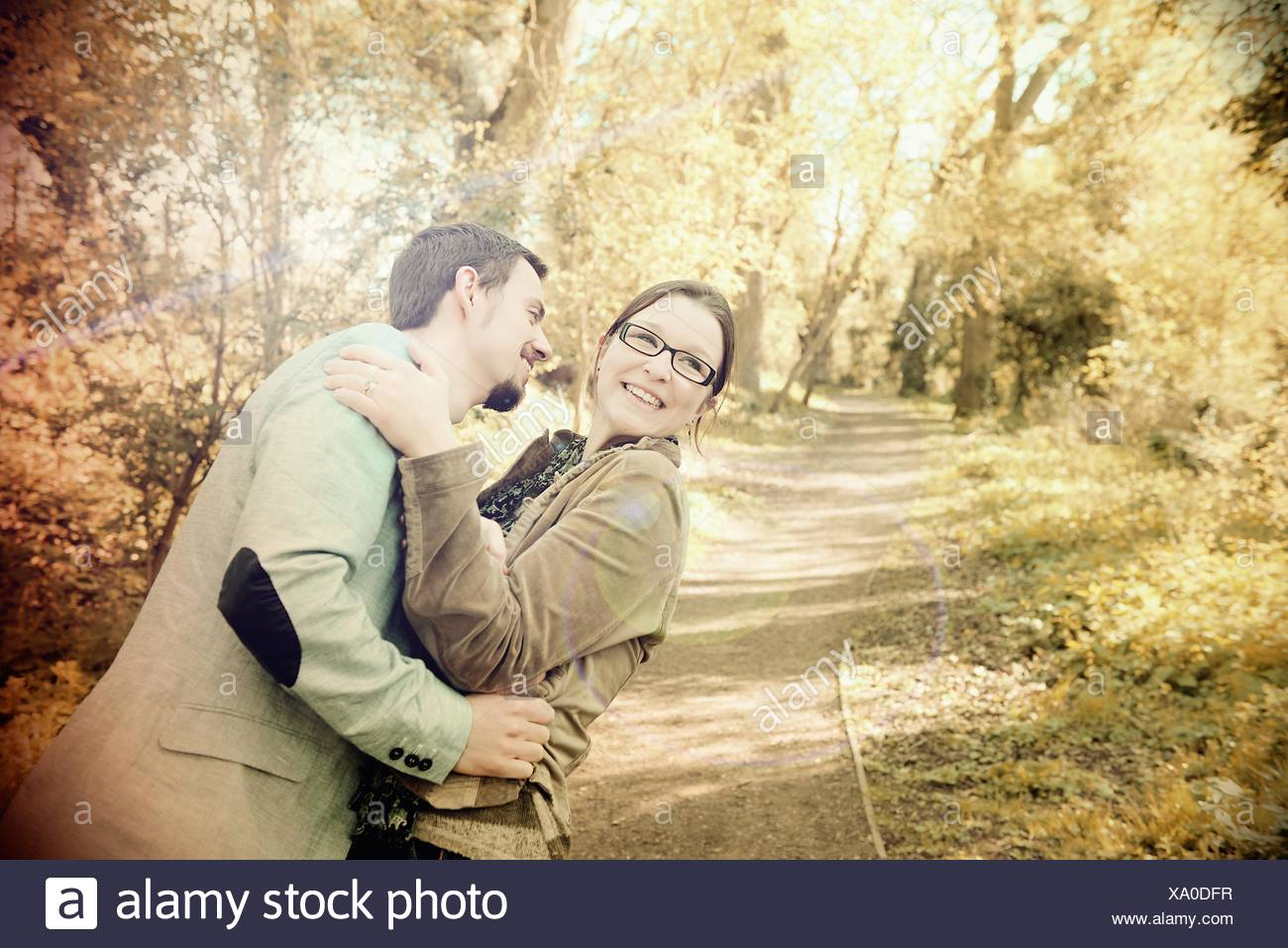 Lovers embracing outdoors - Stock Image