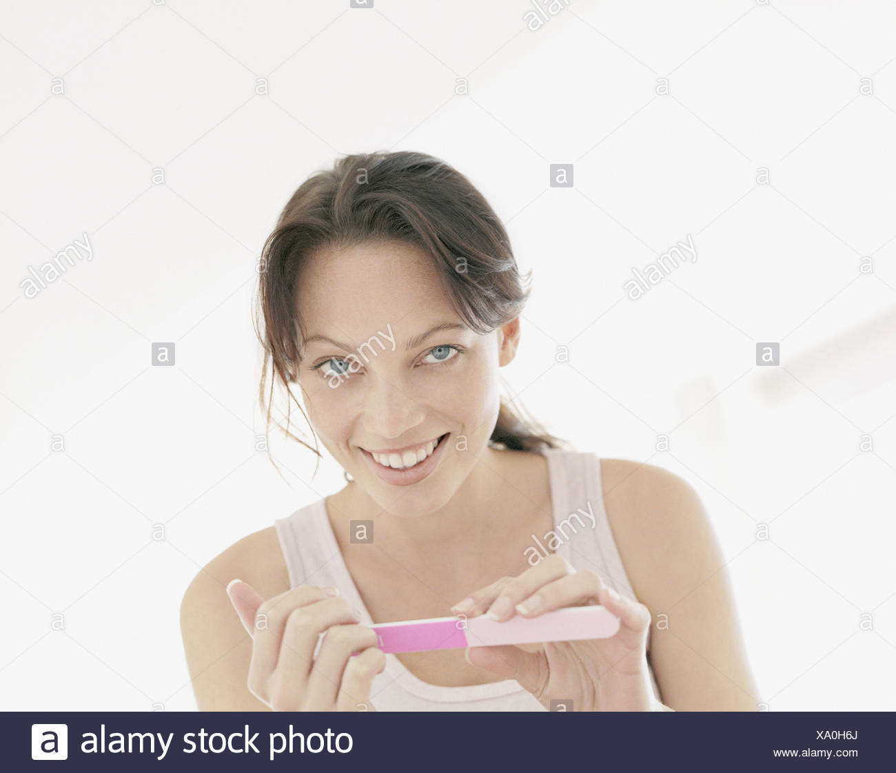 A woman doing her nails - Stock Image
