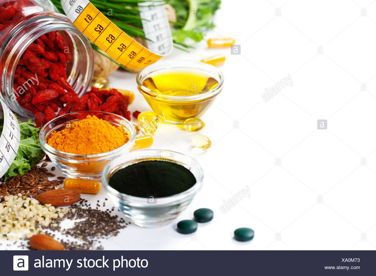 Alternative natural medicine. Dietary supplements. Spirulina, turmeric  and organic oil on white background. Superfood, detox or - Stock Image