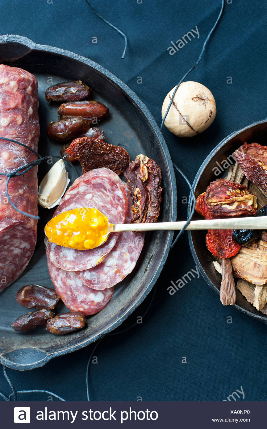 Salami dates corn relish and mushrooms - Stock Image