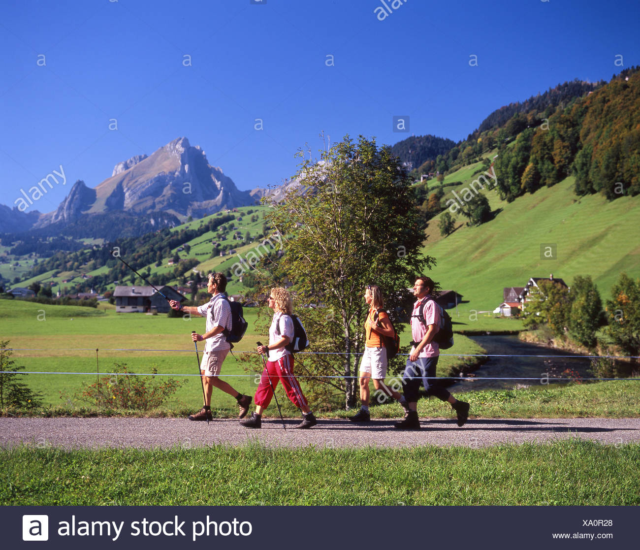 Switzerland Europe Alt St.Johann Canton St.Gallen Toggenburg river Thur hikers hiker hiking four persons gro - Stock Image
