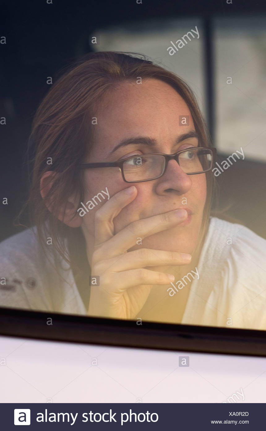 Greece, Ionian Islands, Ithaca, Woman looking from car window, smiling, close up - Stock Image
