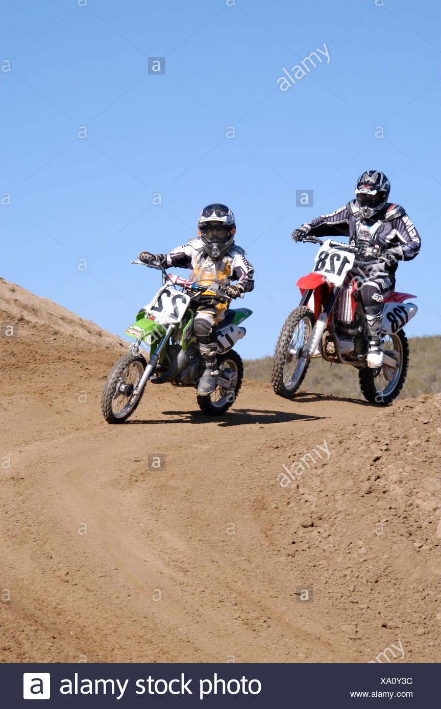 action Moto cross motor sport motorbike motorcycle running Sports - Stock Image