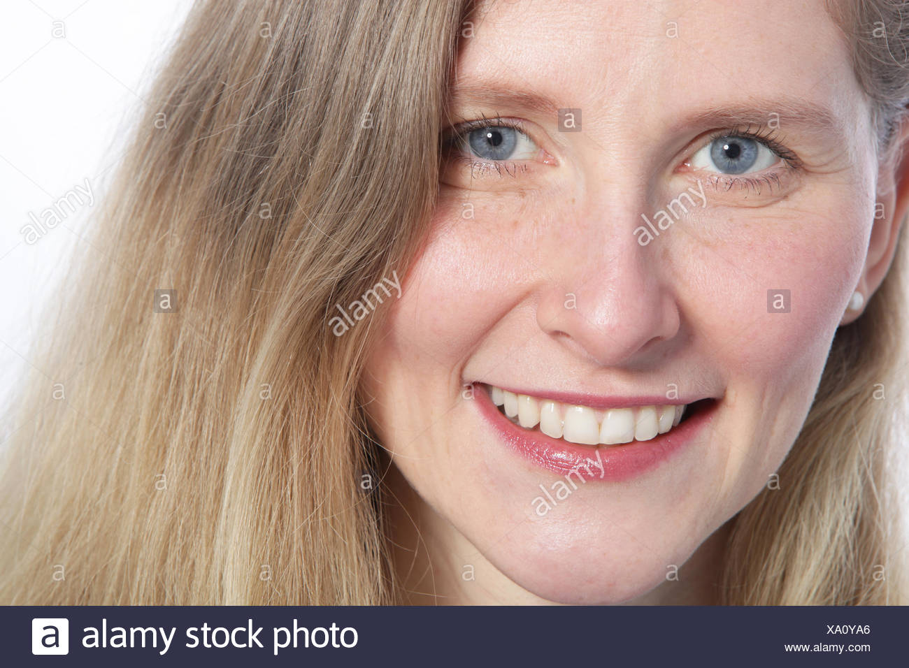 Close up of an attractive woman with blue eyes - Stock Image