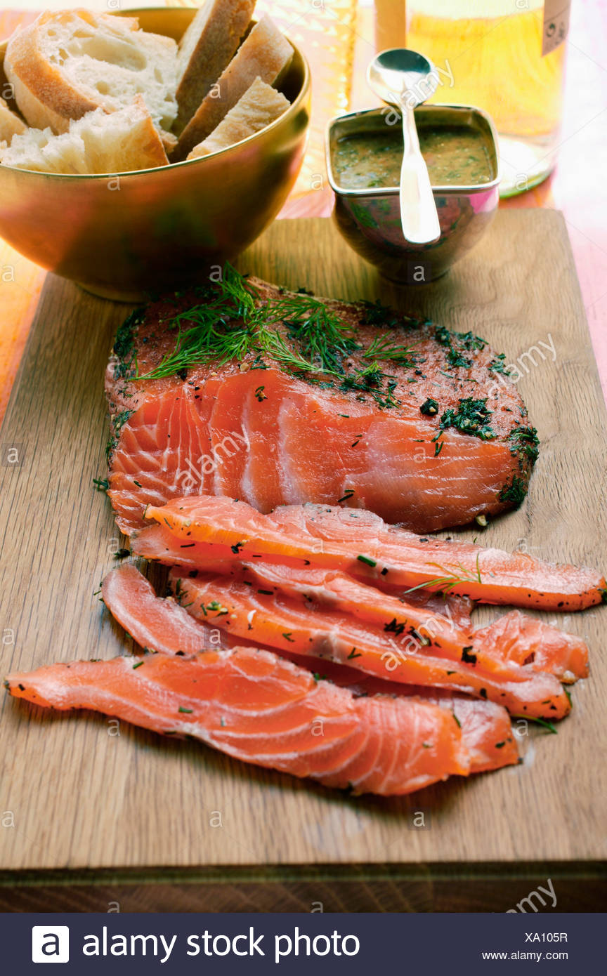 Graved lachs with dill mustard sauce baguette - Stock Image
