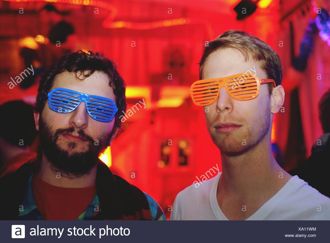 Portrait Of Friends Wearing Novelty Glasses - Stock Image
