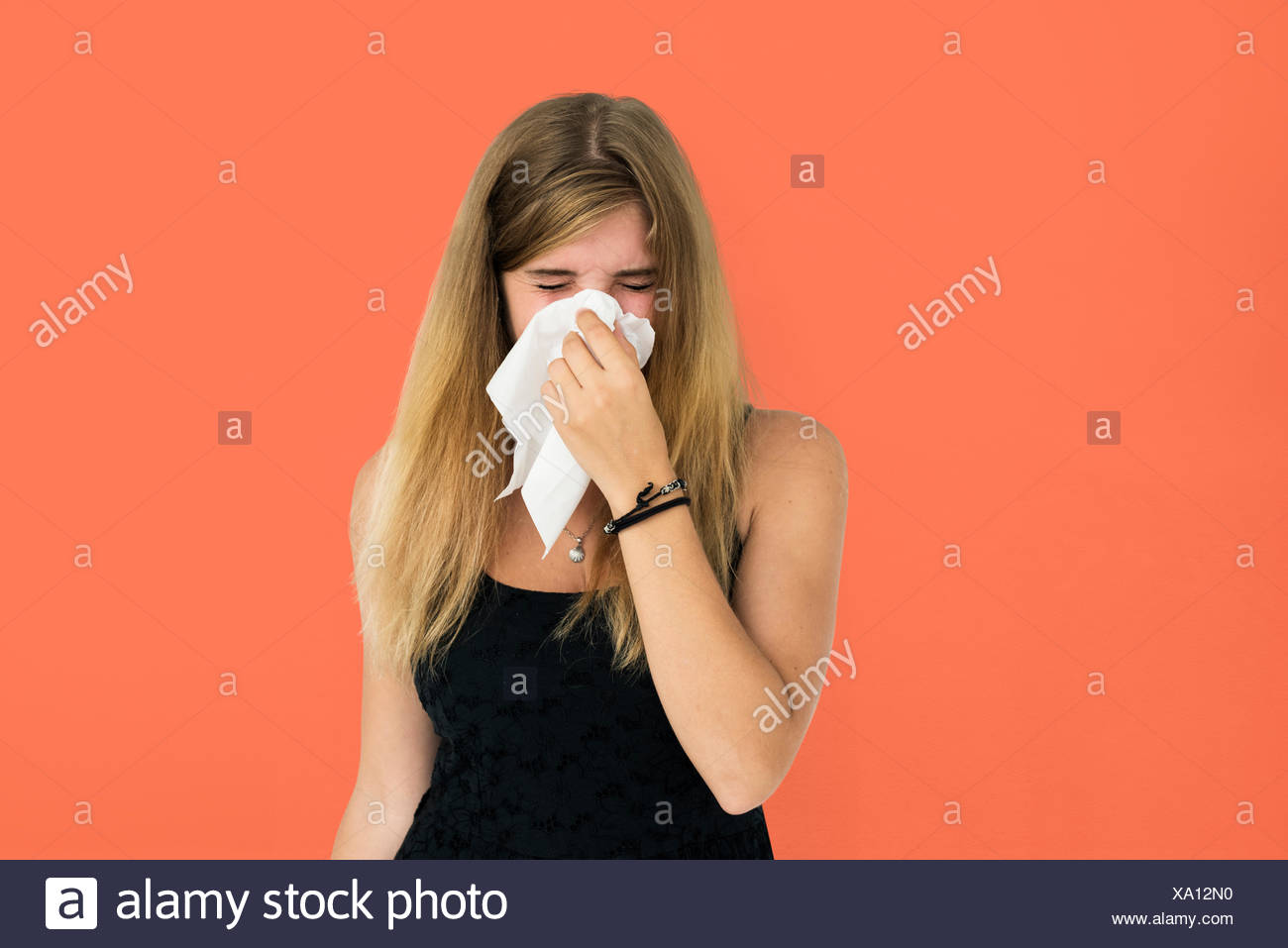 Blonde Girl Crying Sneezing Concept - Stock Image