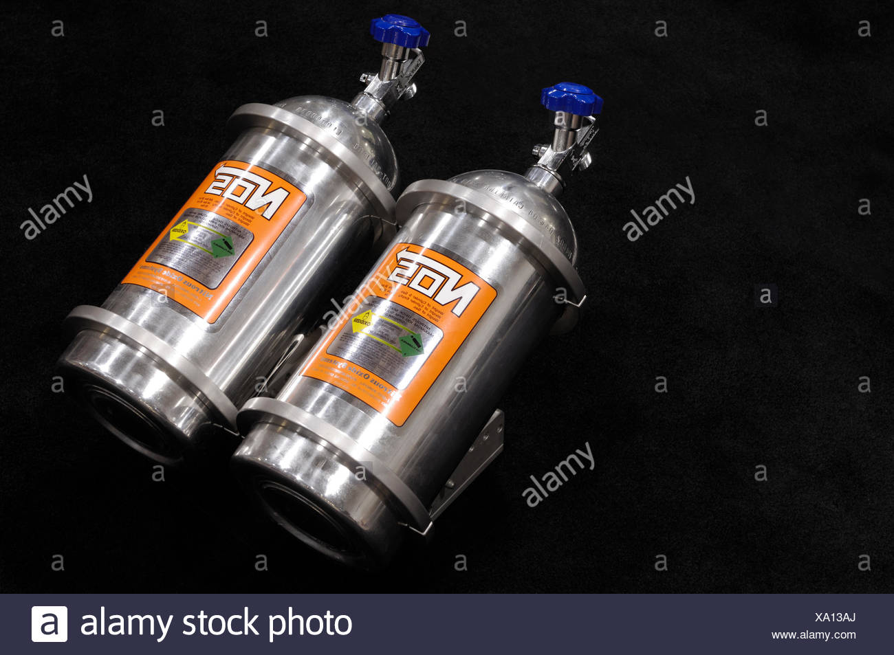 NOS Nitrous Oxide Systems Cylinders with compressed nitrous oxide gas for racing cars - Stock Image