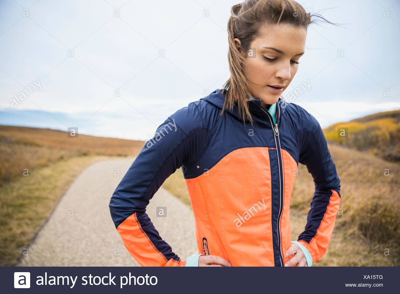 Runner resting on rural path - Stock Image