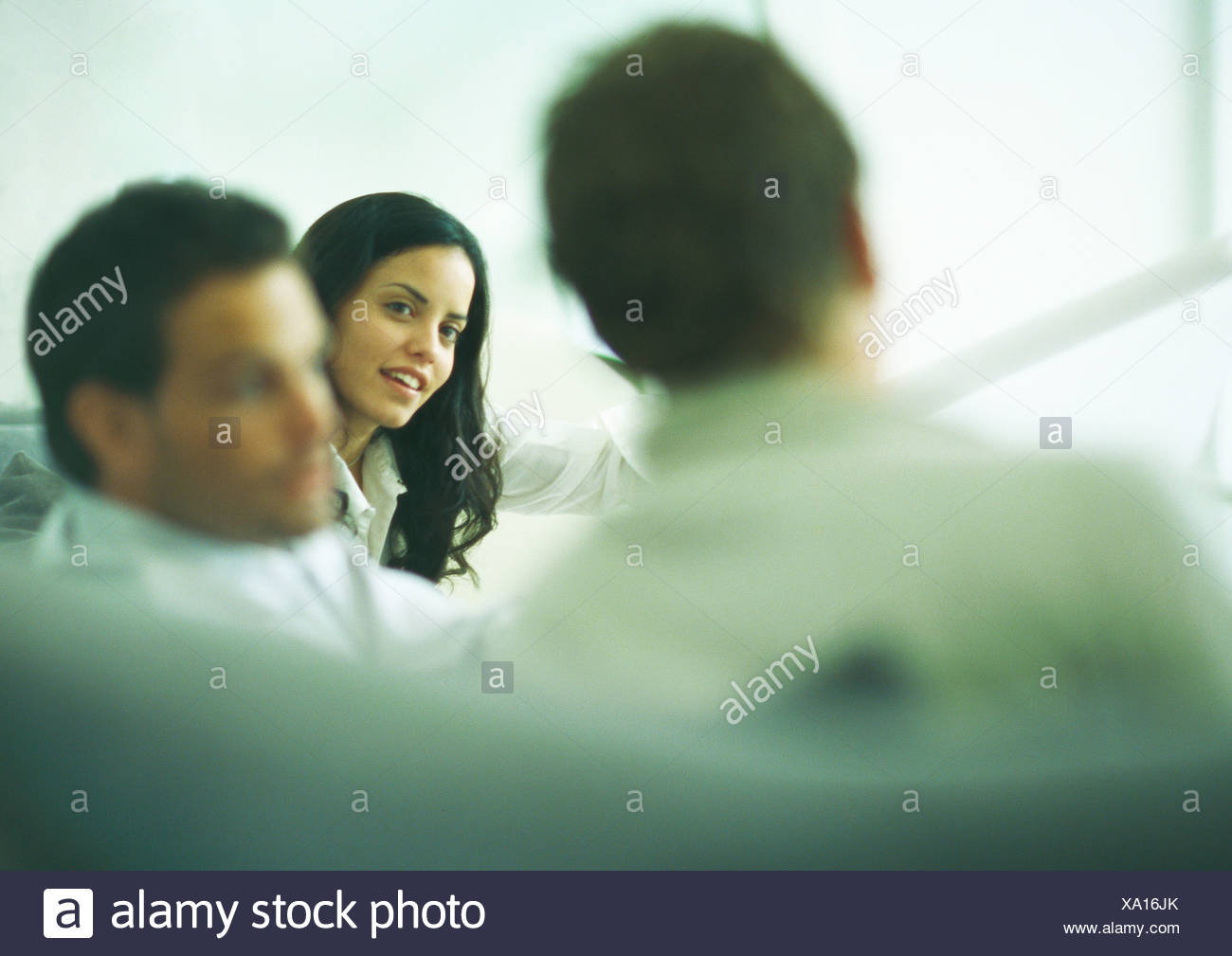 Young adults engaged in discussion - Stock Image