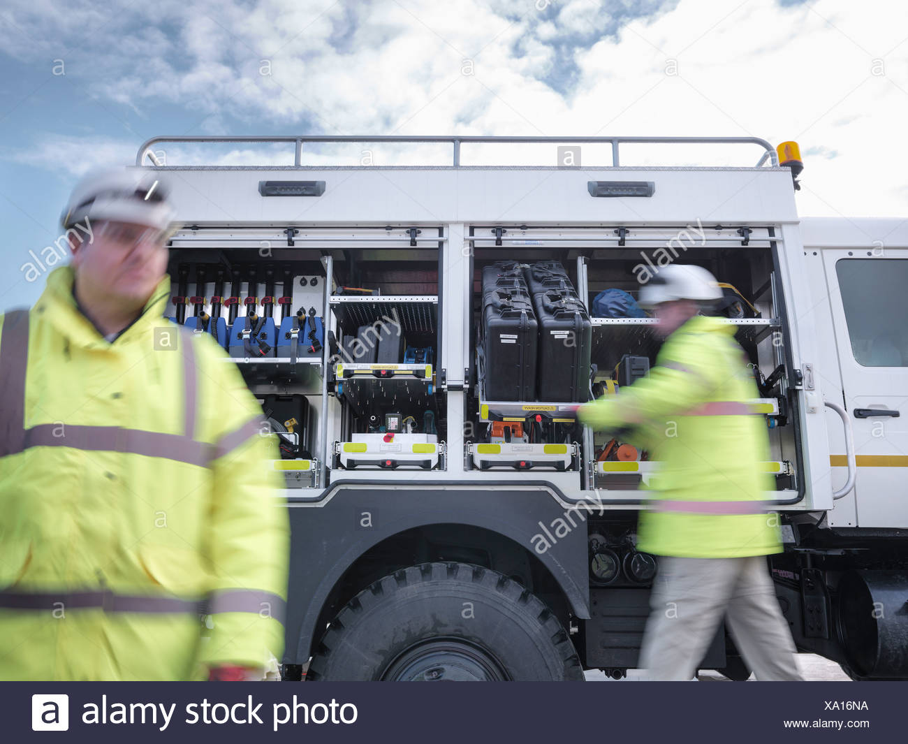 Emergency Response workers with specialist equipment and rescue truck - Stock Image