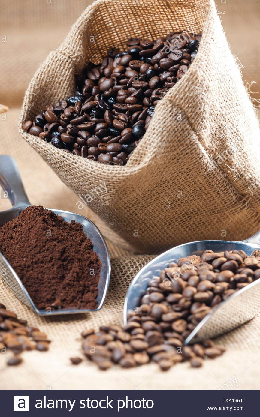 still life of coffee beans in jute bag. - Stock Image