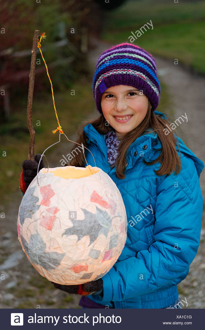 Girl with a lantern at a St. Martin's parade, lantern procession, St. Martin's Day, Pfaffenwinkel, Bavaria, Germany, Europe - Stock Image