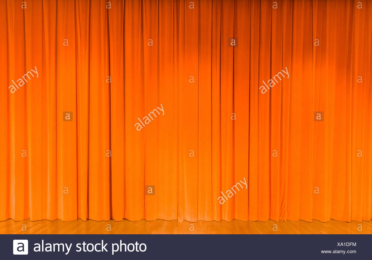 A curtain in orange, theater stage - Stock Image