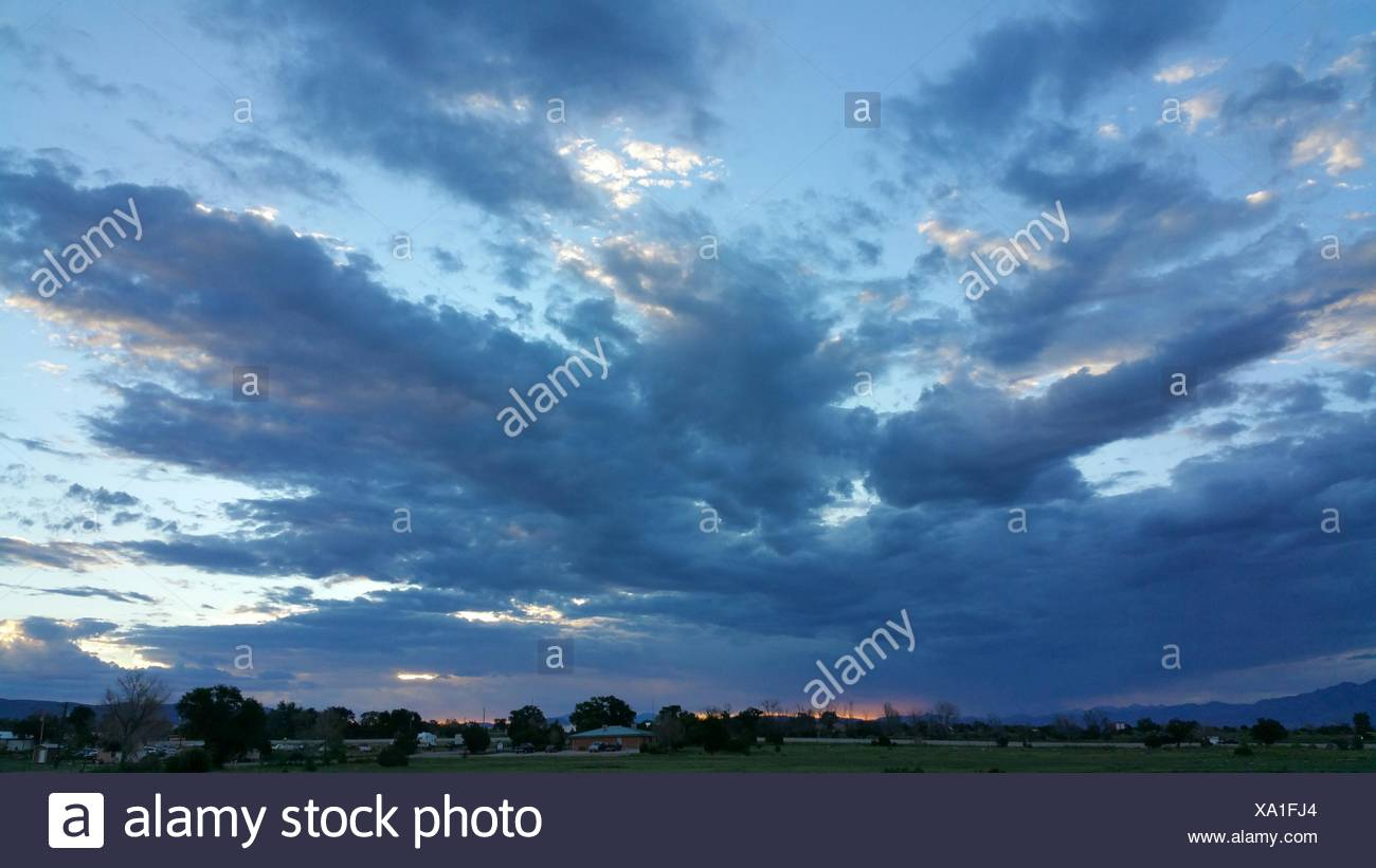 Landscape Against Cloudy Sky During Sunset - Stock Image