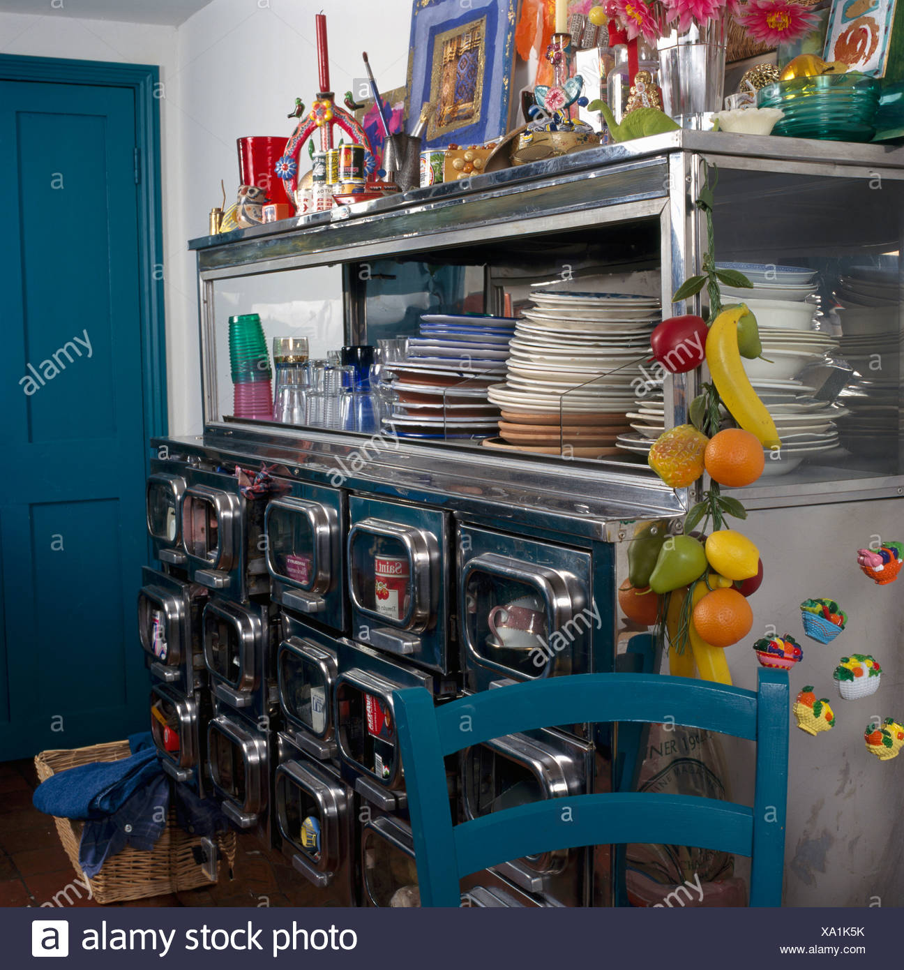 Stacks Of Plates On Fifties Metal Dresser With Storage Drawers And