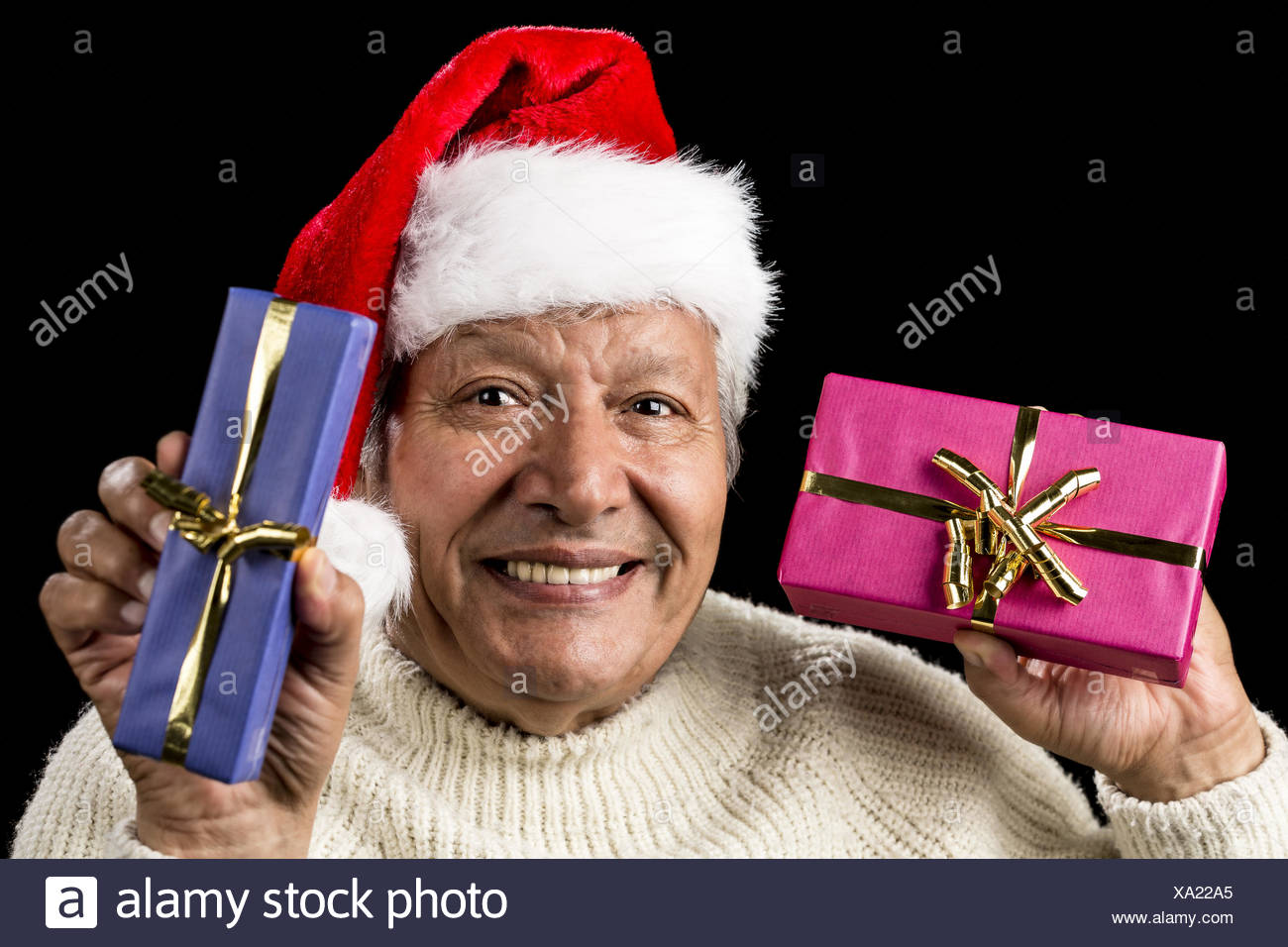 Lighthearted, Smiling Old Man Offering Two Gifts - Stock Image